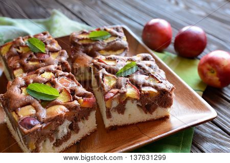 Nectarine sponge cake on a wooden background