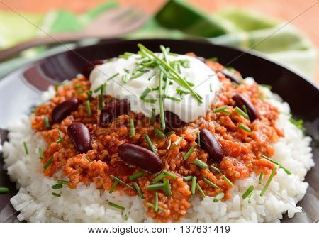 Mexican food Chili con carne on a wooden background