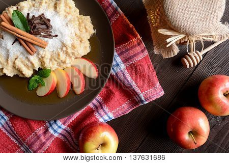 Sweet millet porridge with honey, apples and grated coconut