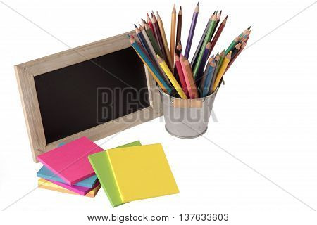 notes blackboard and colored pencils isolated on white background