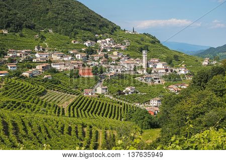 Small town of Valdobbiadene surrounded by vineyards zone of production of traditional italian white sparkling wine Prosecco