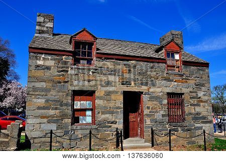 Washington DC - April 10 2014: Early 19th century lock keeper's stone house still stands on the National Mall which was once a canal *
