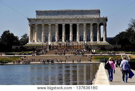 Washington DC - April 10 2014: View from the Reflecting Pool on the National Mall to the Lincoln Memorial
