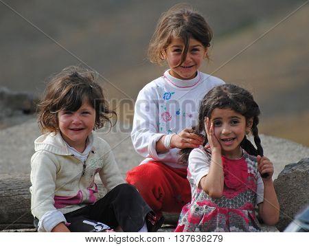 Xinaliq, Azerbaijan - August 23, 2014. Young Xinaliq beauties.Three little girls in Xinaliq mountainous village in Azerbaijan.