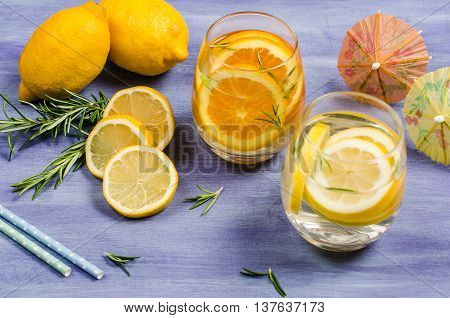 Detox fruit infused flavored water. Refreshing summer homemade cocktail with lemon and orange