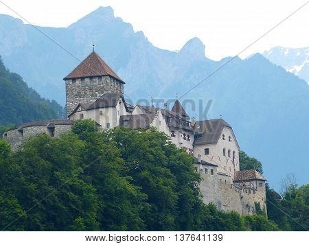 Vaduz, Liechtenstein - July 9, 2013. Schloss Vaduz looms over the capital of Liechtenstein from the hill above.