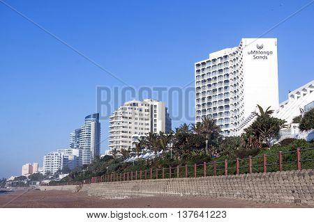 Beach Front City Skyline Against Blue Sky