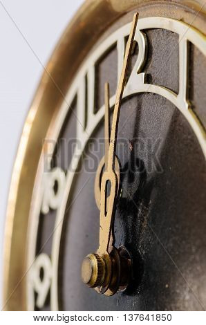 Hands old clock on the background of the figure twelve close up