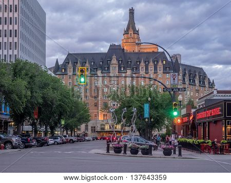 SASKATOON, CANADA - JULY 2: Landmark Delta Bessborough Hotel on July 2, 2016 in Saskatoon, Saskatchewan, Canada. Setting sun strikes the central tower of the Bessborough, a four star hotel.