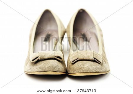 Pair of female shoes over white background