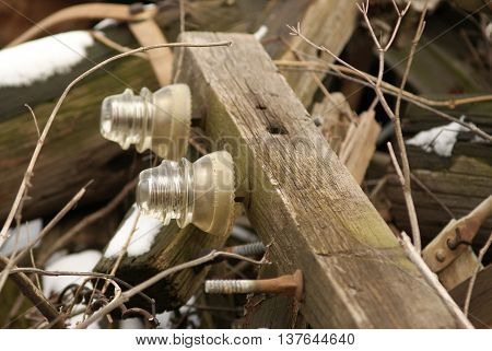Duo of Clear glass antique phone insulators on wood