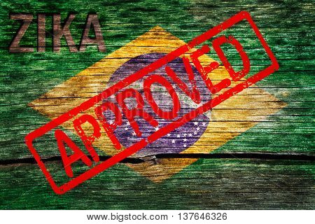 Brazil flag painted on the old cracked wood with word zika and approved warning before the virus infection