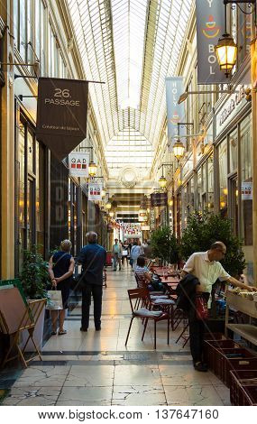 Paris; France-July 07 2016: The passage Verdeau was built in 1847. It is one of the most charming covering arcades in Paris with a lot of antique boutiques and unique shops.