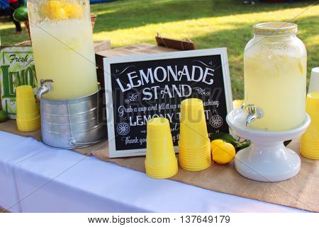 Homemade lemonade in a jar with cups