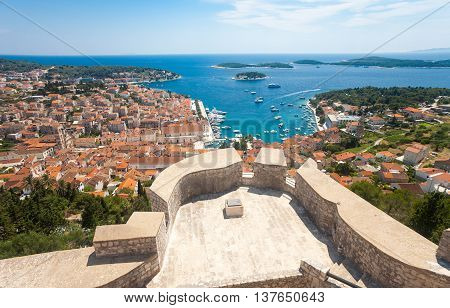 Wide angle aerial view of Hvar city and the bay from the Spanish fortress