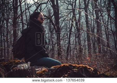 The girl in the afternoon in the autumn wood