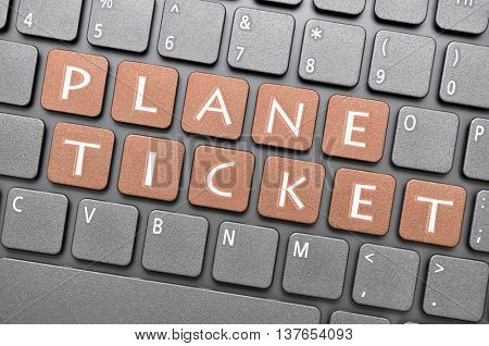 Gunmetal plane ticket key on keyboard