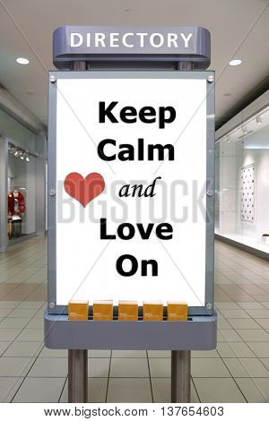 Keep calm and love on sign inside shopping mall