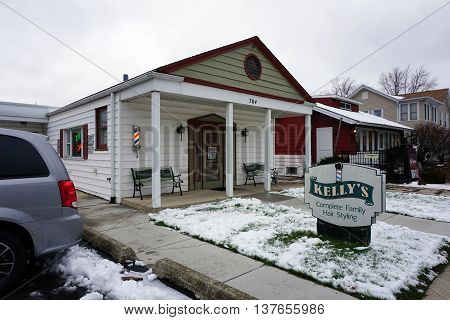 PLAINFIELD, ILLINOIS / UNITED STATES - DECEMBER 29, 2015: One may have one's hair cut at Kelly's Compete Family Hair Styling in downtown Plainfield.