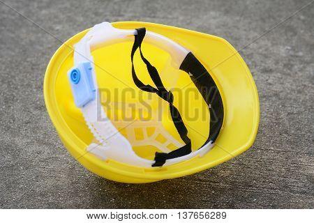 Helmet yellow on brown old wooden floor