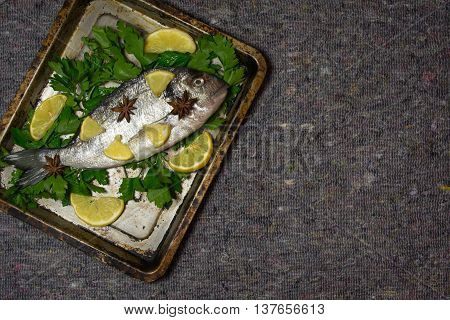 Raw dorado with spicies on pan for cooking