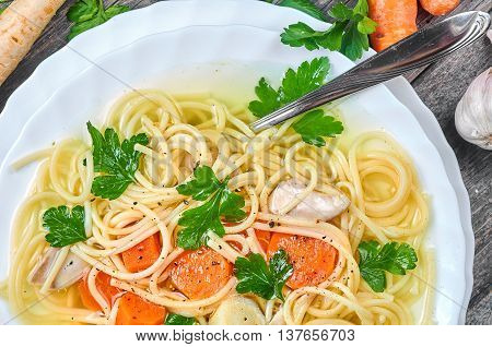 Classic chicken soup with noodles and vegetables