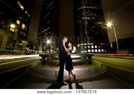 Los Angeles nightlife with an interracial dating couple on a busy downtown street at night