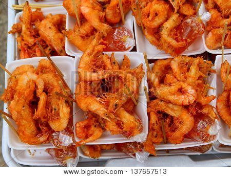 deep-fried shrimp for sale in white, styrofoam trays, southern Thailand beach