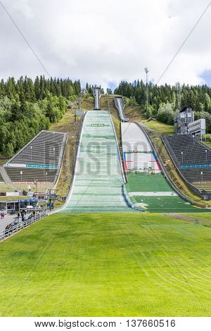 LILLEHAMMER, NORWAY - JUNE 27: Repair crews are preparing for summer ski jumping competition on June 27, 2016 in Lillehammer, Norway. Lillehammer is the center of winter sports.