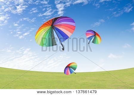 Colourful umbrellas floating in the blue sky