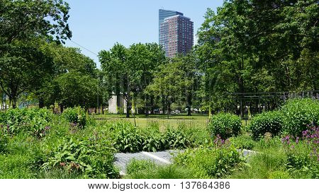 NEW YORK, NY - JUN 19: Battery Park in New York City, as seen on Jun 19, 2016. It is a 25-acre public park located at the southern tip of Manhattan Island in New York City, facing New York Harbor.