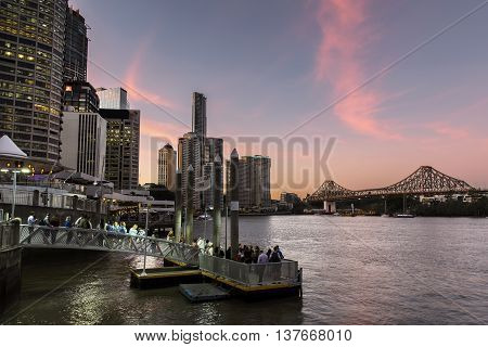 BRISBANE, AUSTRALIA - MAY 25 2016: Colourful sunset over Brisbane citycape and Story Bridge, view from Eagle Street Pier