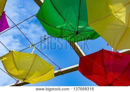 Yellow Green And Red Umbrellas Hanging Reversely
