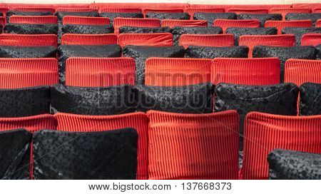 Empty chairs of red and black colors in auditorium