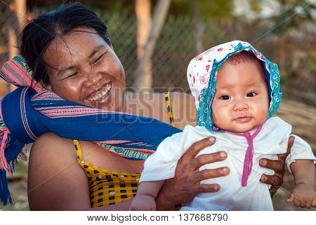 Gia Lai, Vietnam, June 21, 2016 she and her grandson, ethnic Ede, Gia Lai, Vietnam, cuddling together