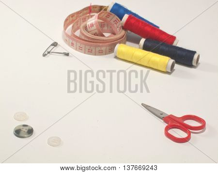 sewing and knitting tools or accesories for needlework on white background