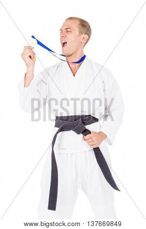 Fighter holding gold medal and screaming aloud on white background