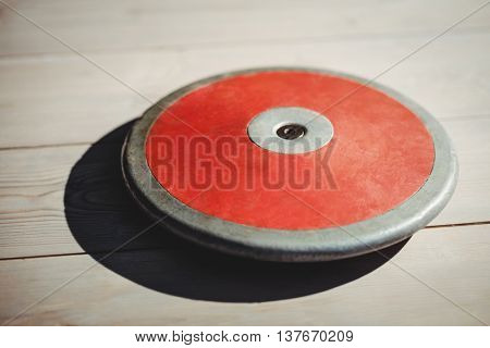 Close up of discus on wooden background