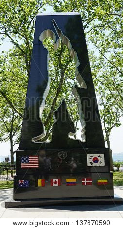 NEW YORK, NY - JUN 19: Korean War Memorial in Battery Park in New York, as seen on Jun 19, 2016. It honors military personnel who served in Korean Conflict 1950-1953. It was designed by Mac Adams.