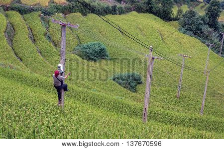 YEN BAI, VIETNAM, June 13, 2016 man, rowing repair power poles, mountainous, Yen Bai, Vietnam