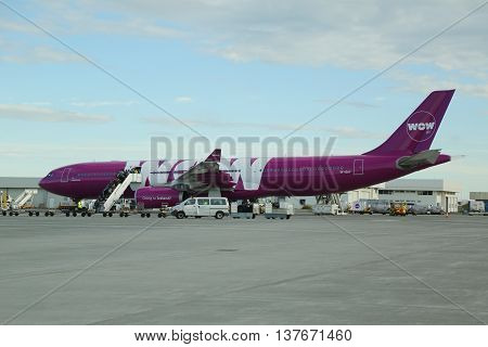 REYKJAVIK, ICELAND - JULY 3, 2016:Wow Air aircraft on tarmac at Keflavik International Airport. WOW air is an Icelandic low-cost carrier