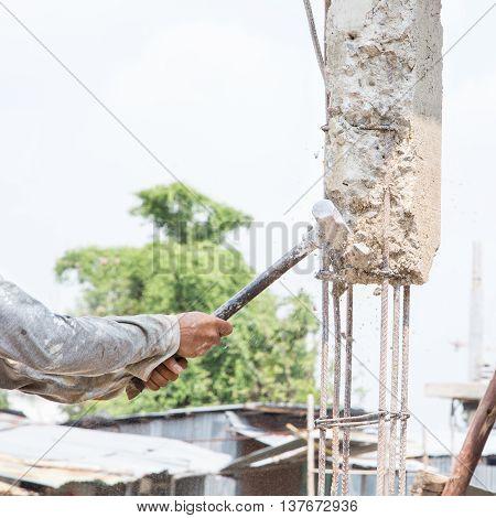 building site worker destroys concrete for renovation house