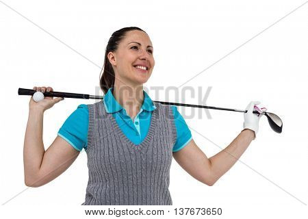 Golf player holding a golf club and golf ball on white background