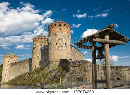 Fortress in the city of Savonlinna in Finland against the blue summer sky ringing bell
