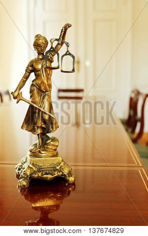 closeup of Themis in lawyer's office .