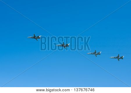 four russian combat jets in the air