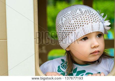portrait cute baby girl in white cap