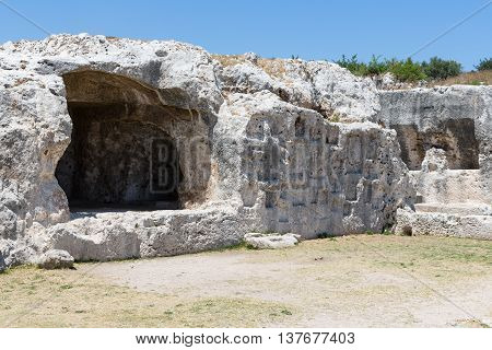 Rock dwellings at Archaeological Park Neapolis at Syracusa Sicily Italy