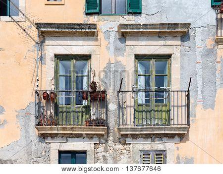 Old houses with balcony at Syracuse Sicily Italy