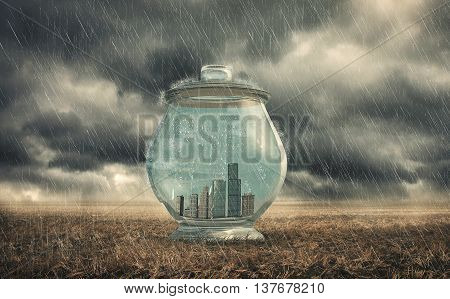 Buildings in a glass jar the concept of protection against pollution. Safe from rain.